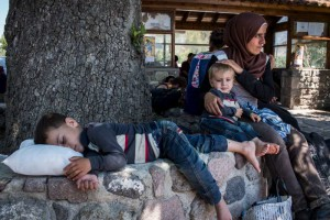 A refugee mother and her two children rest after arriving by boat on the island of Lesvos.