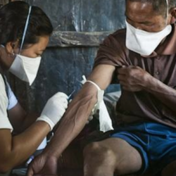 Local staff nurse draws blood from MDRTB patient Seikholien, 45, for laboratory testing. Churchandpur, Manipur, India - 24, October 2012. Credit: MSF